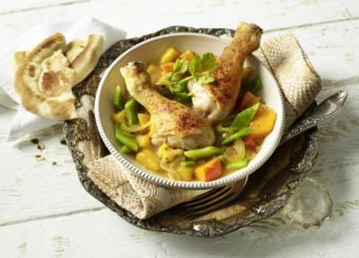 Hähnchen-Drumstick-Curry mit Kürbis und grüner Mango